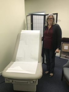 Project HELP executive director Eileen Wesley with new ADA-approved bed